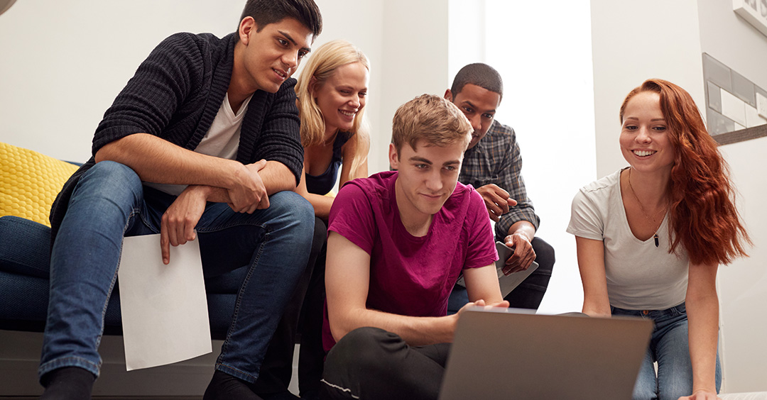 Photo of Group Of College Students In Lounge Of Shared House Studying Together to illustrate student accommodation